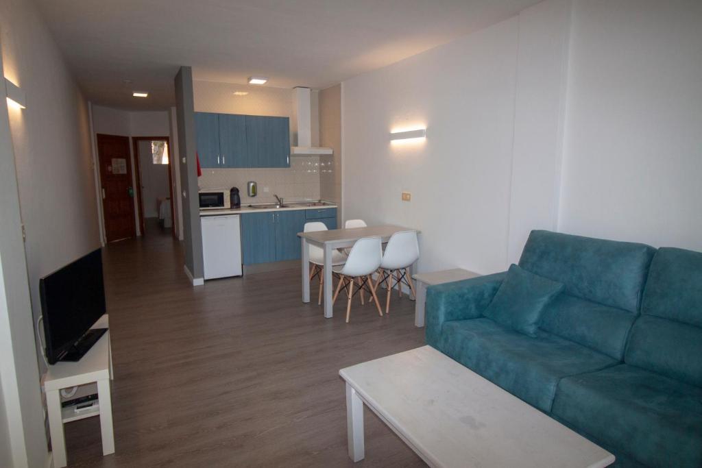 A kitchen or kitchenette at Apartamentos Portinatx Sea View