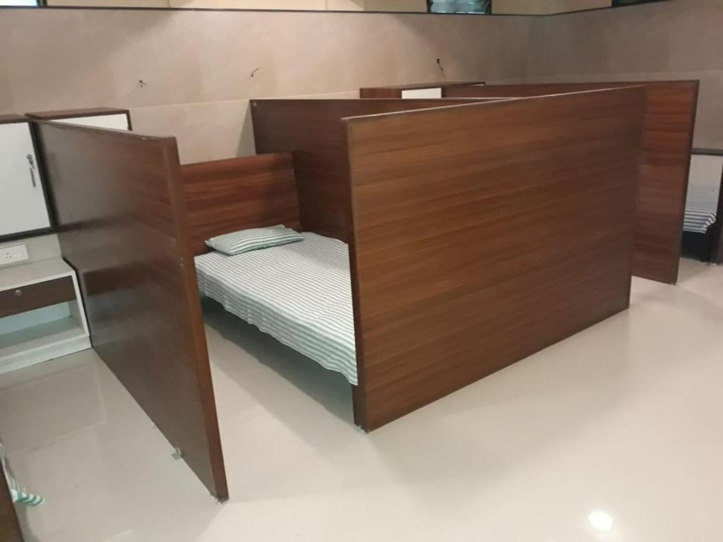 A bed or beds in a room at Kubera Dormitory