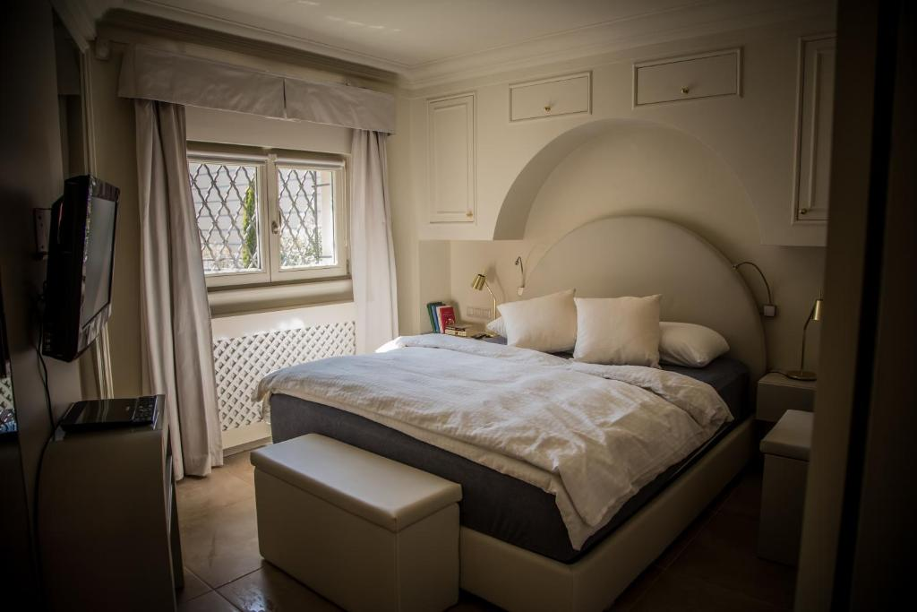 A bed or beds in a room at President Boutique Apartment