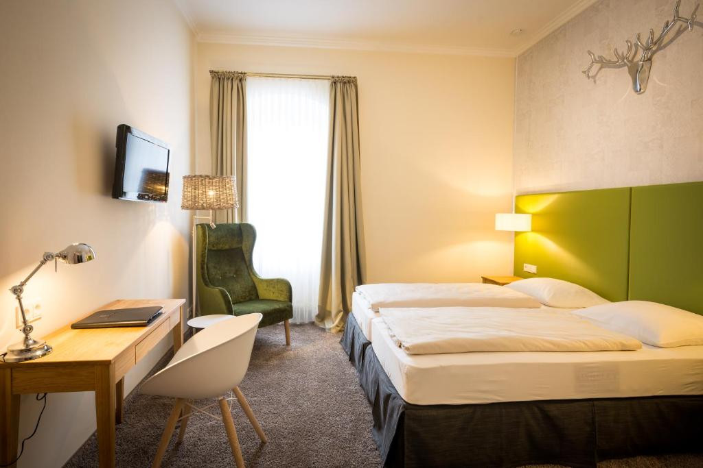 Ein Bett oder Betten in einem Zimmer der Unterkunft Hotel Deutschherrenhof