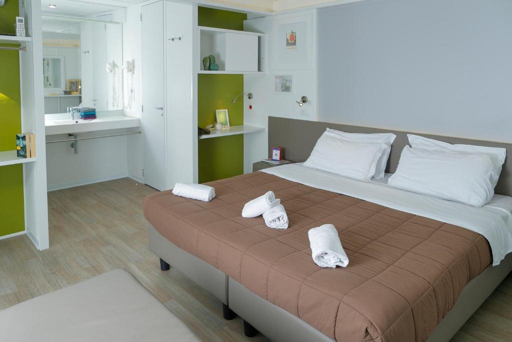 Łóżko lub łóżka w pokoju w obiekcie Firenze Camping In Town