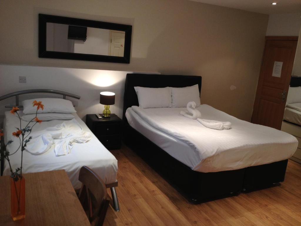 Cama o camas de una habitación en 274 Suites