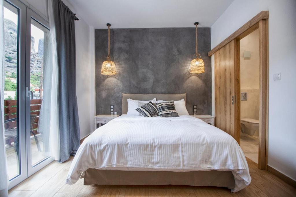 Ένα ή περισσότερα κρεβάτια σε δωμάτιο στο Oikia guesthouse