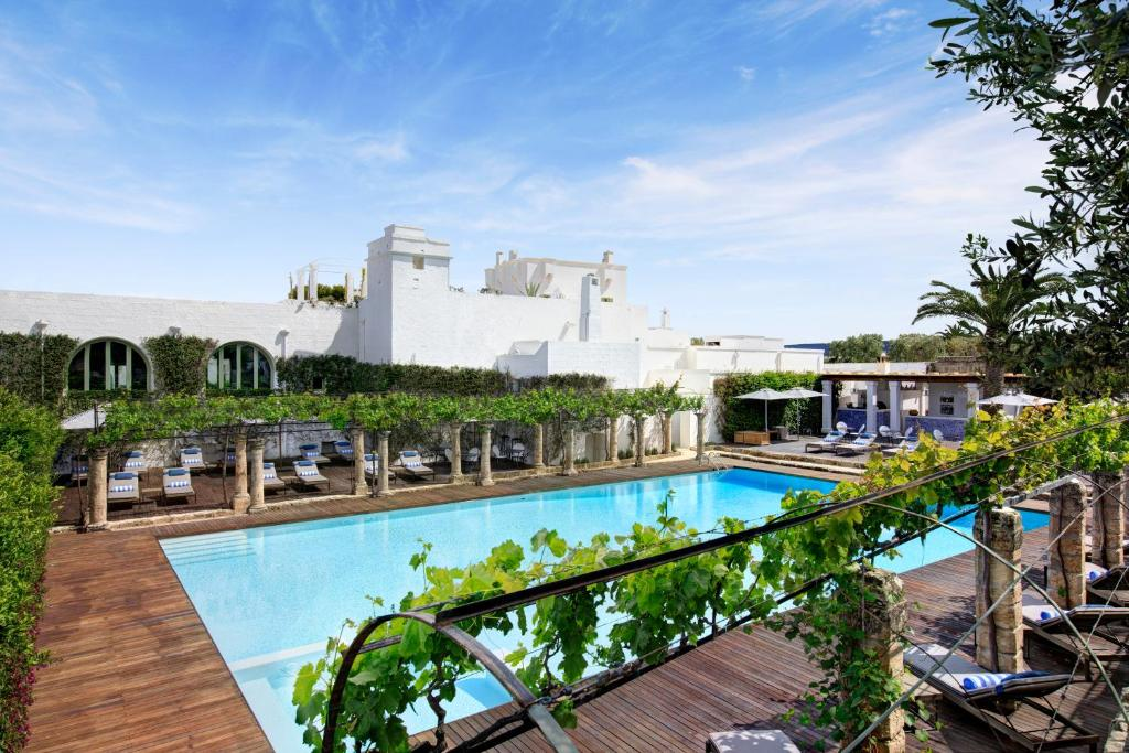 A view of the pool at Rocco Forte Masseria Torre Maizza or nearby