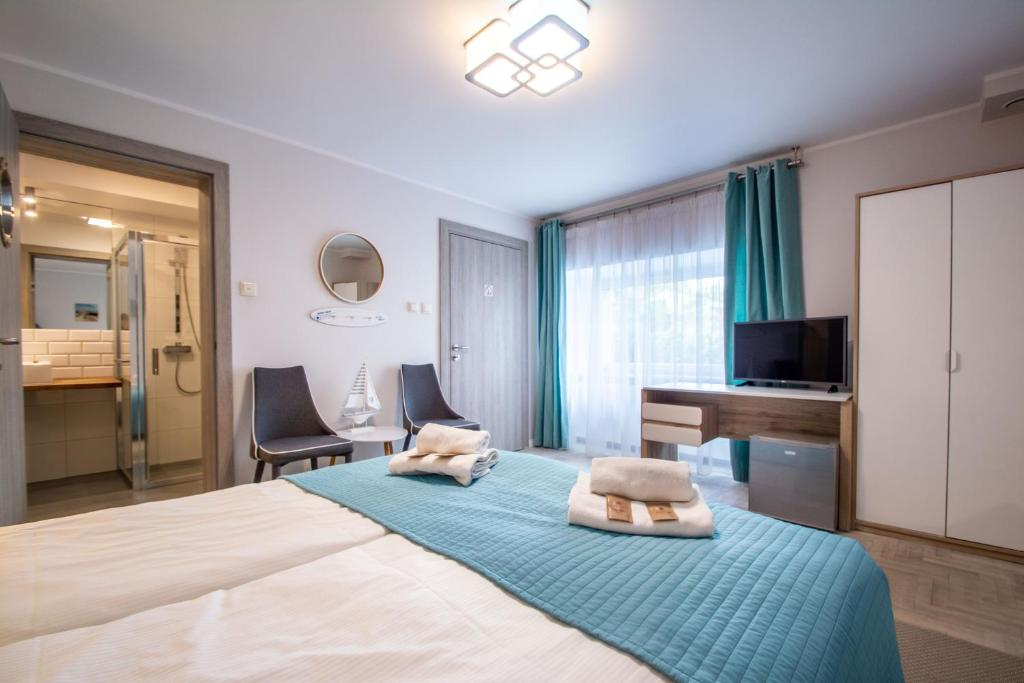 A bed or beds in a room at Beach House - przy plaży