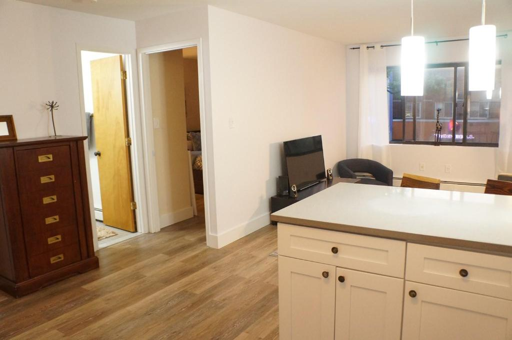 A television and/or entertainment center at Times Square of ASTORIA Spacious Modern 4bd 2bath 3rd Floor