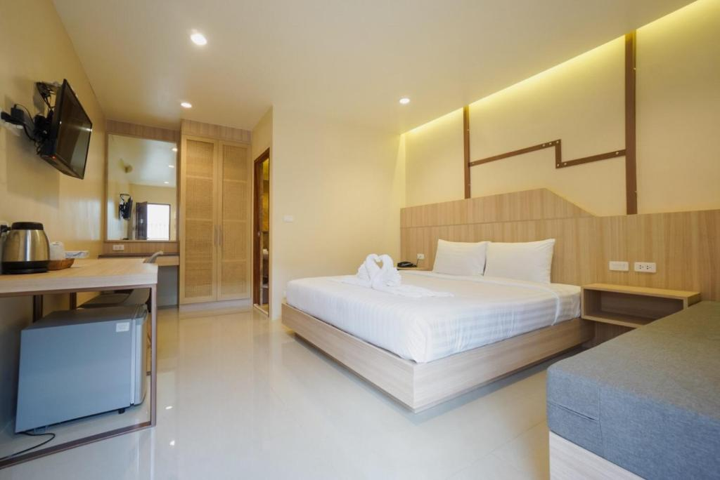 A bed or beds in a room at The Way Patong Hotel