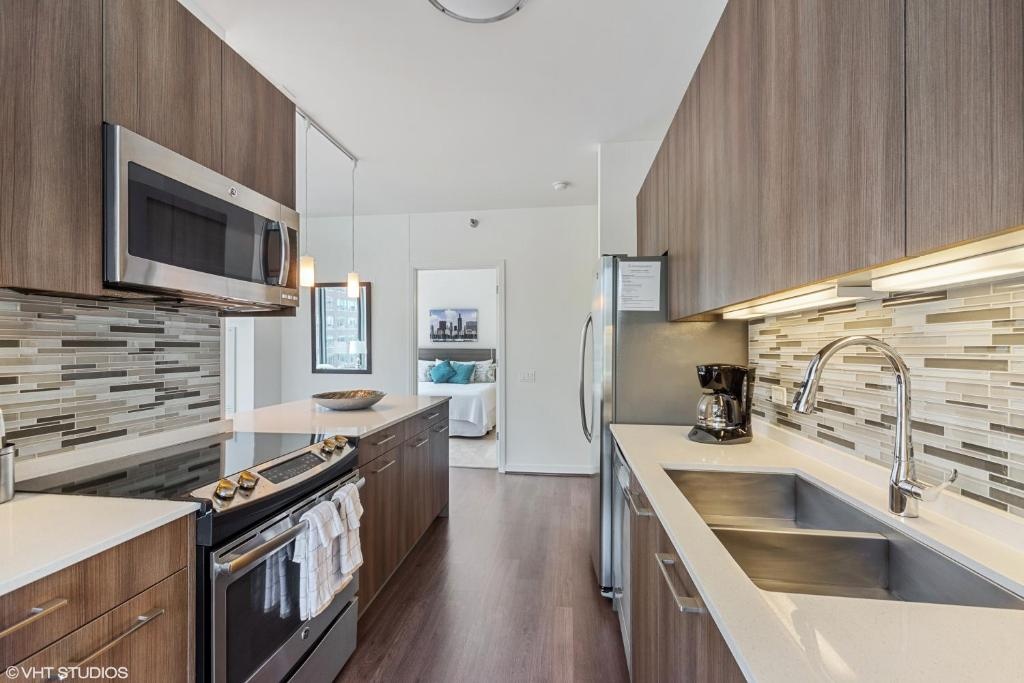 A kitchen or kitchenette at Corporate Suites Network - River North Luxury 2 Bedroom