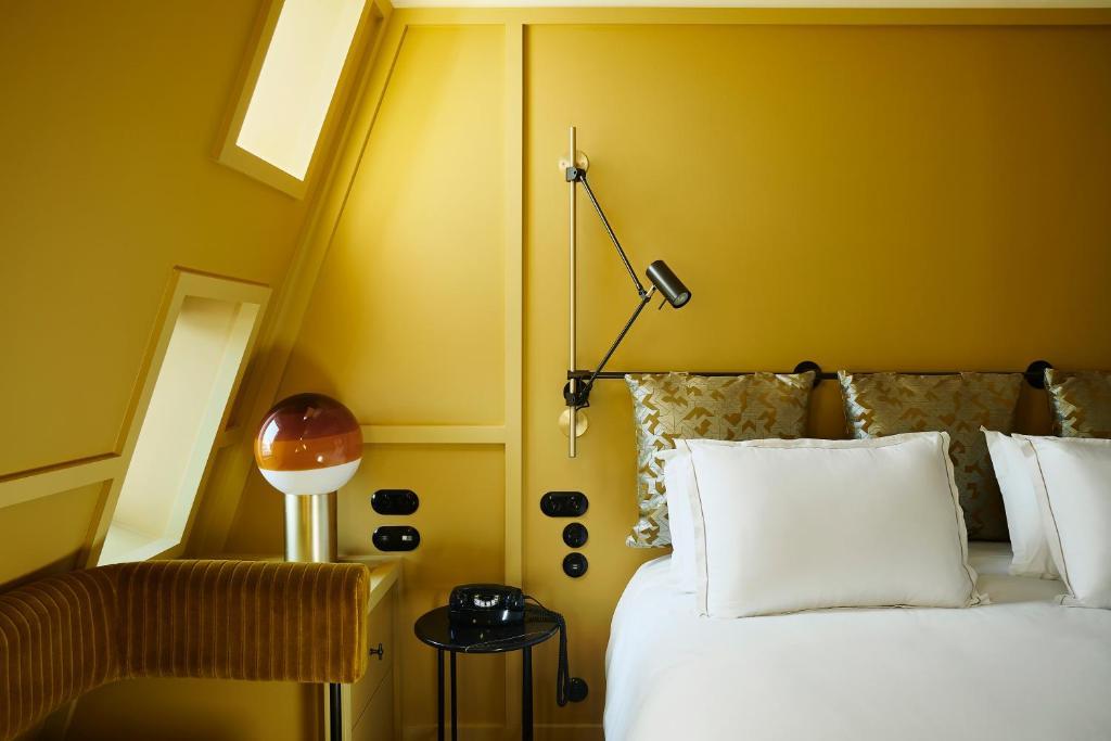 Un ou plusieurs lits dans un hébergement de l'établissement Hôtel Le Ballu
