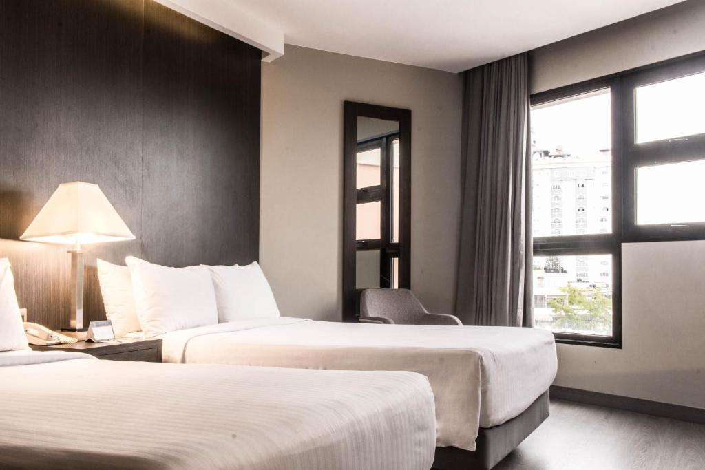 A bed or beds in a room at W&P Santo Domingo