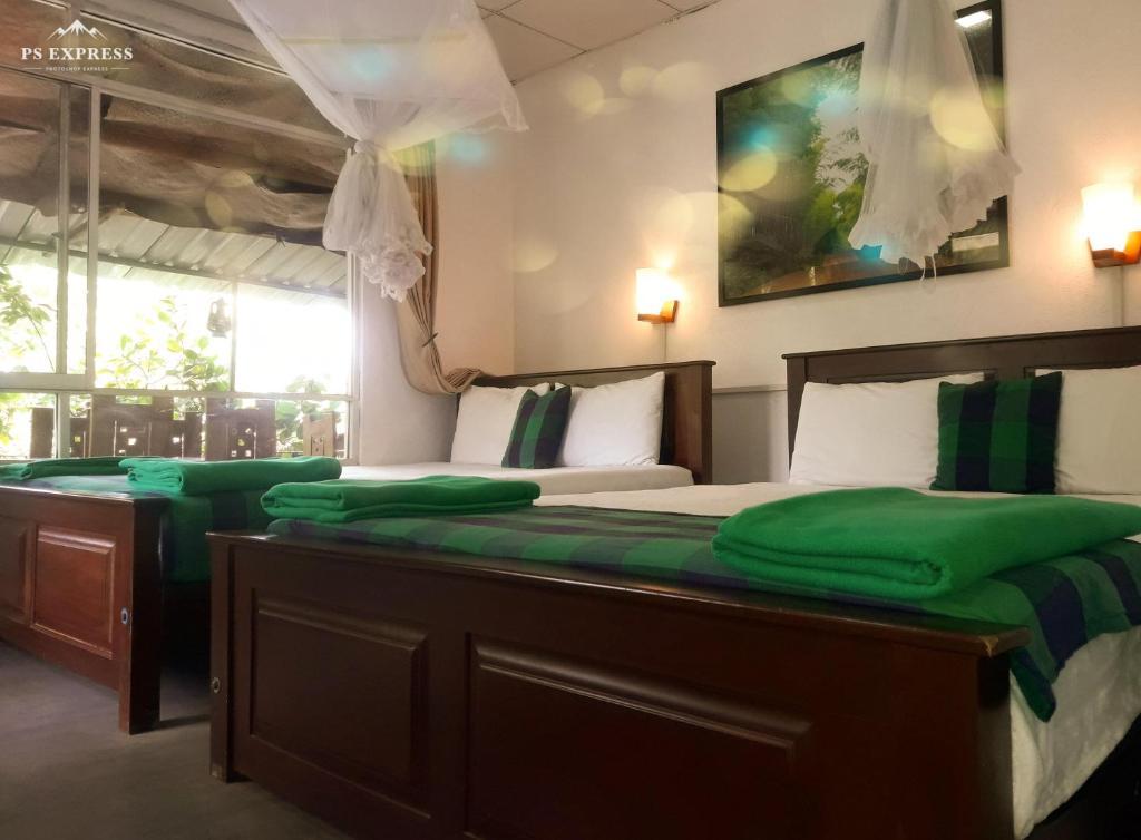 Ein Bett oder Betten in einem Zimmer der Unterkunft ella green stay