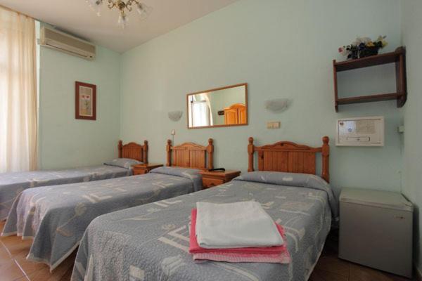 Postel nebo postele na pokoji v ubytování Hostal Fuentesol