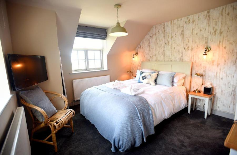 A bed or beds in a room at The Lifeboat Inn