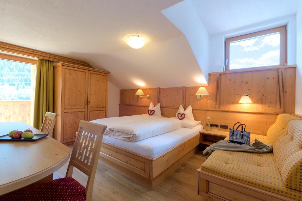 Ein Bett oder Betten in einem Zimmer der Unterkunft Hotel Traube