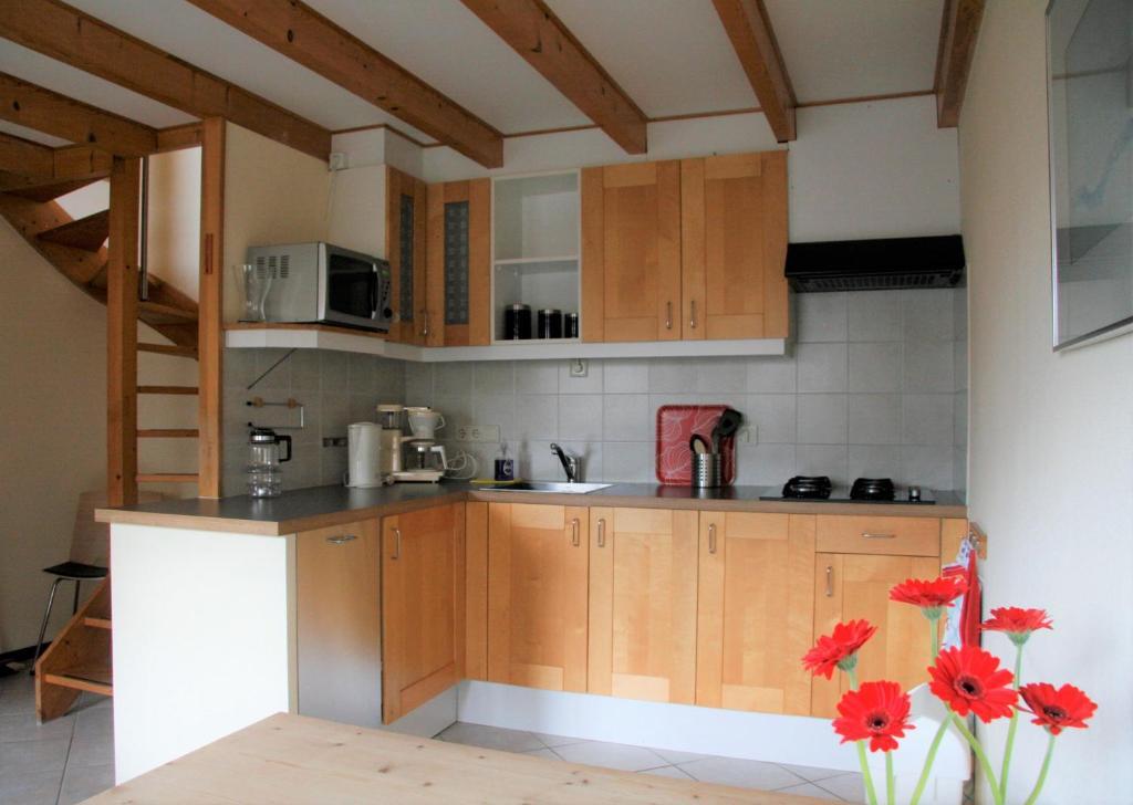 Een keuken of kitchenette bij De Bakkerij