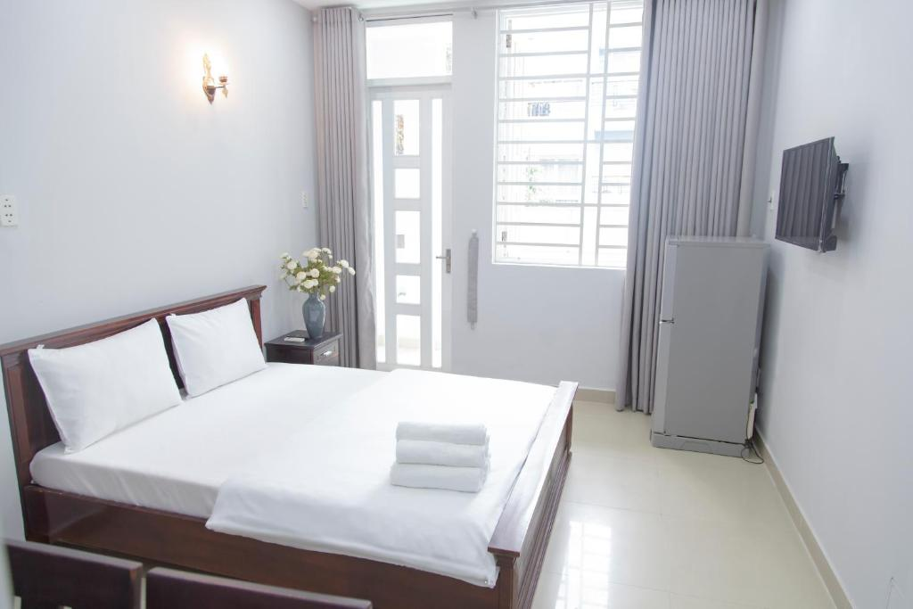 A bed or beds in a room at Ks chờ bay-Waiting Flight Rooms