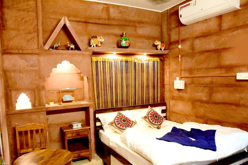 A bed or beds in a room at MH Guest House