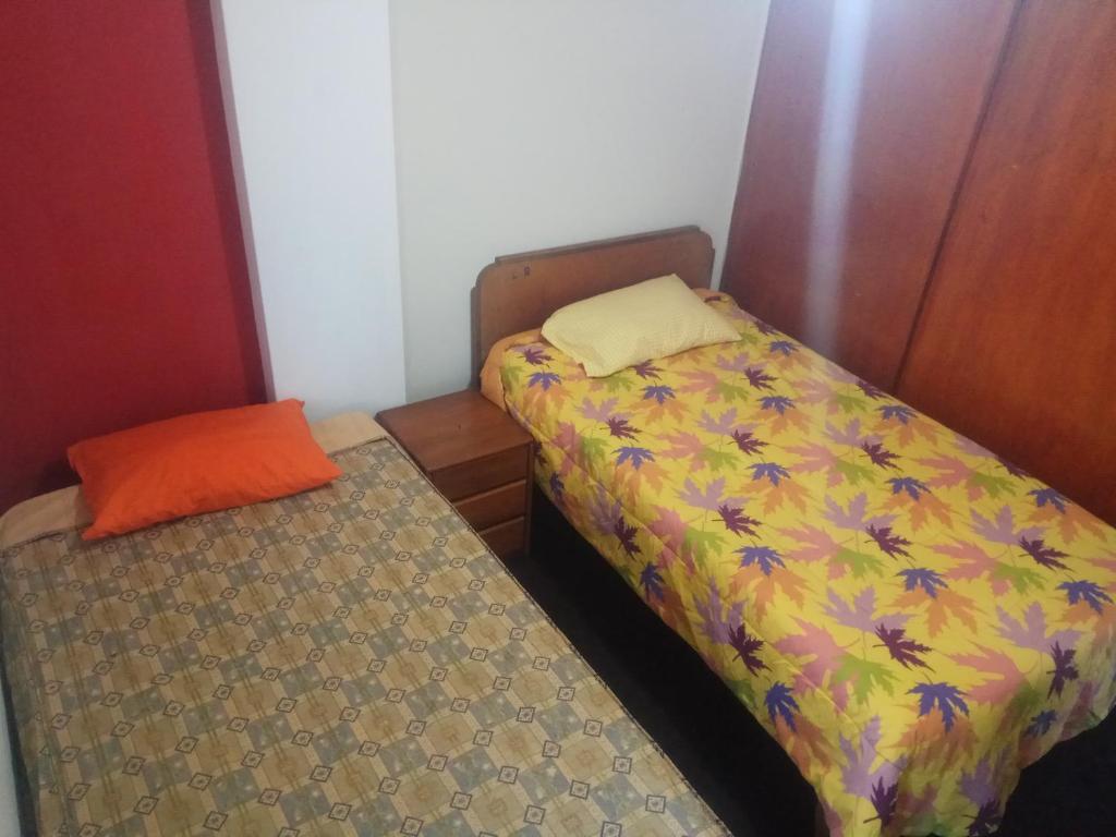 Cama o camas de una habitación en MyG hostel