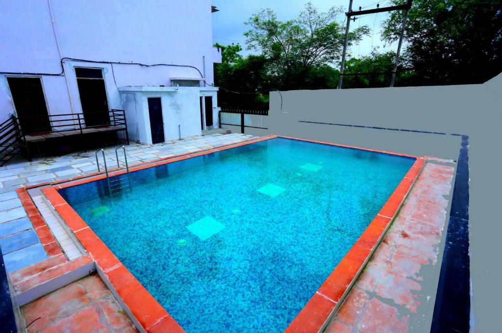 The swimming pool at or near Hotel White Tulip