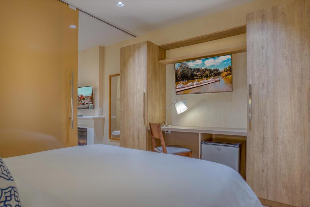 A bed or beds in a room at Apartamento 319 C - Gramado