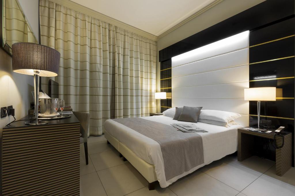 Ein Bett oder Betten in einem Zimmer der Unterkunft Palazzo Salgar