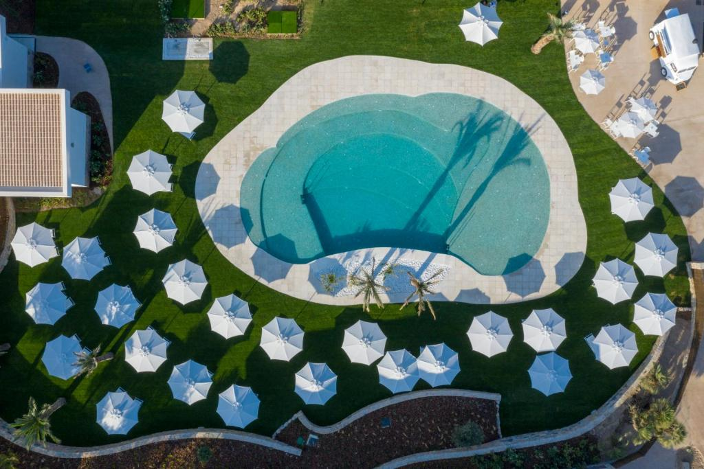 A view of the pool at Las Colinas Golf & Country Club Residences or nearby