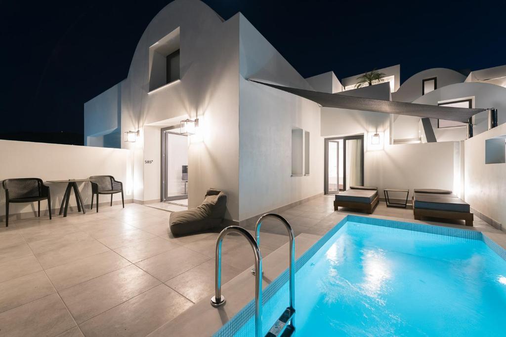 The swimming pool at or near Karat Suites