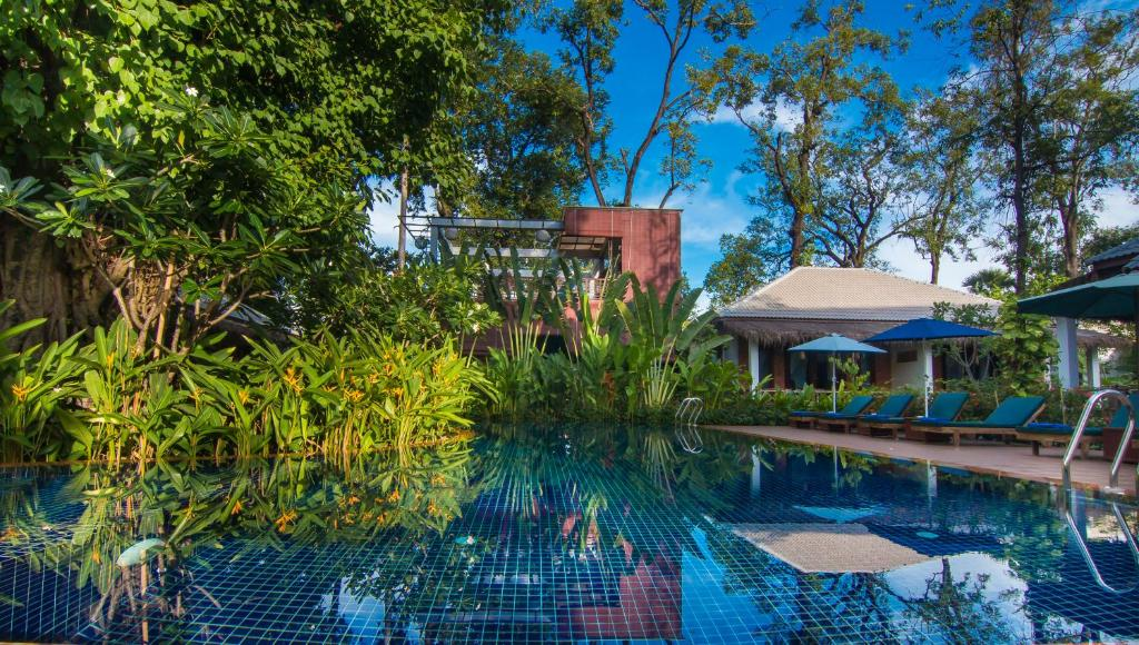 The swimming pool at or near La Rivière d' Angkor Resort