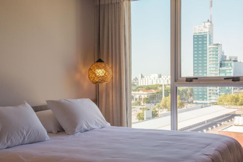 Cama ou camas em um quarto em Hotel Ciudadano Suites