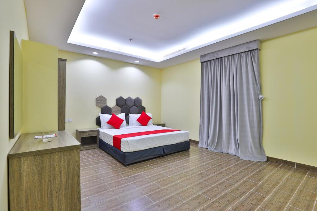 A bed or beds in a room at OYO 238 Shahad Al Taif