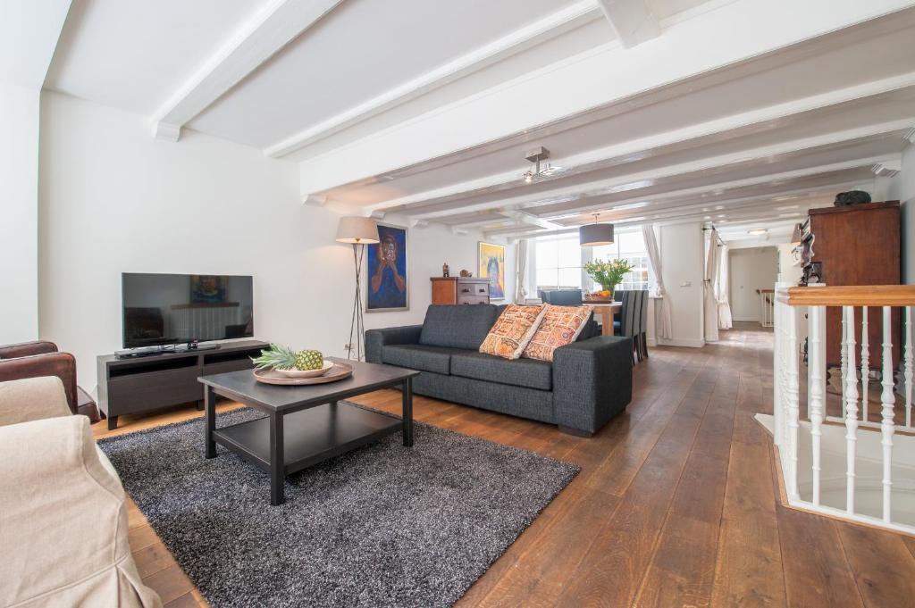 אזור ישיבה ב-Jordaan Noordermarkt Apartments