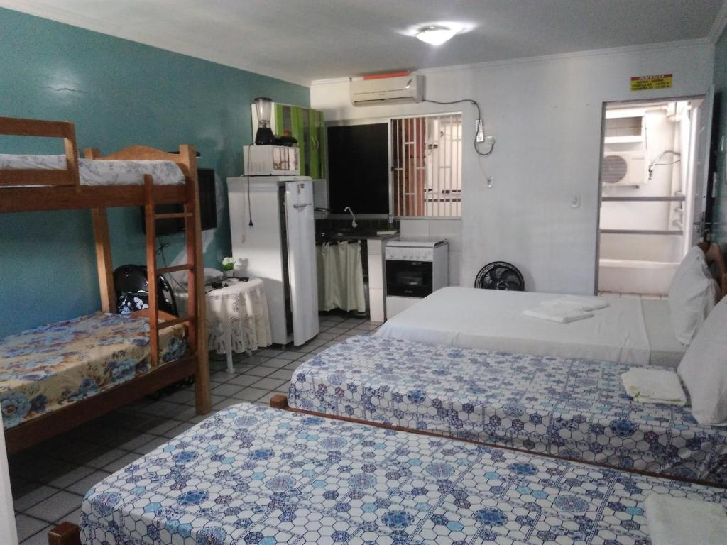 A bunk bed or bunk beds in a room at Pousada Temporada Maceió