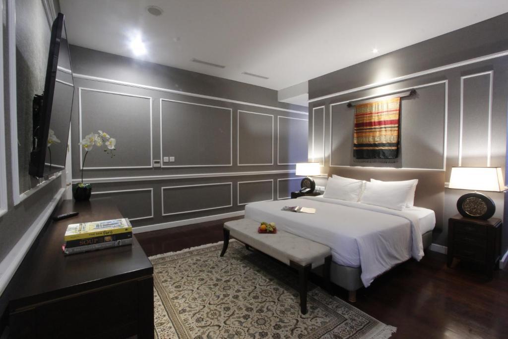 Tempat tidur dalam kamar di Kokoon Hotel Surabaya