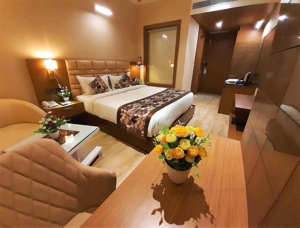 A bed or beds in a room at LEGEND INN
