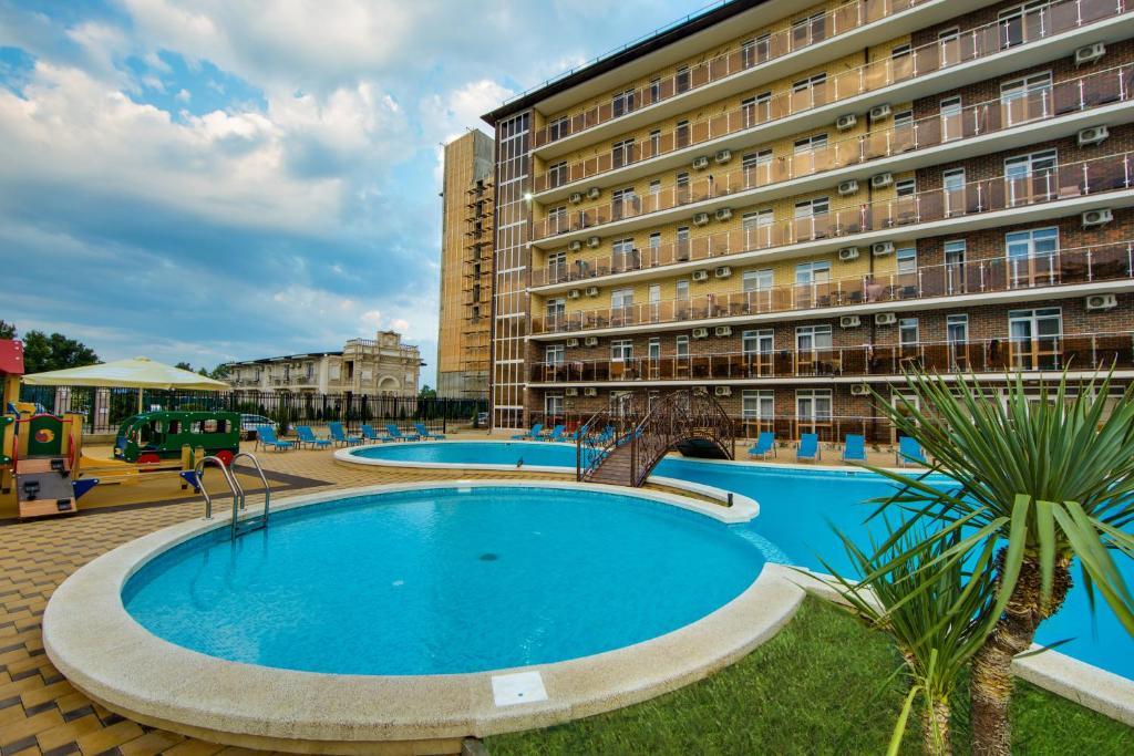 The swimming pool at or close to Hotel Poseidon u morya
