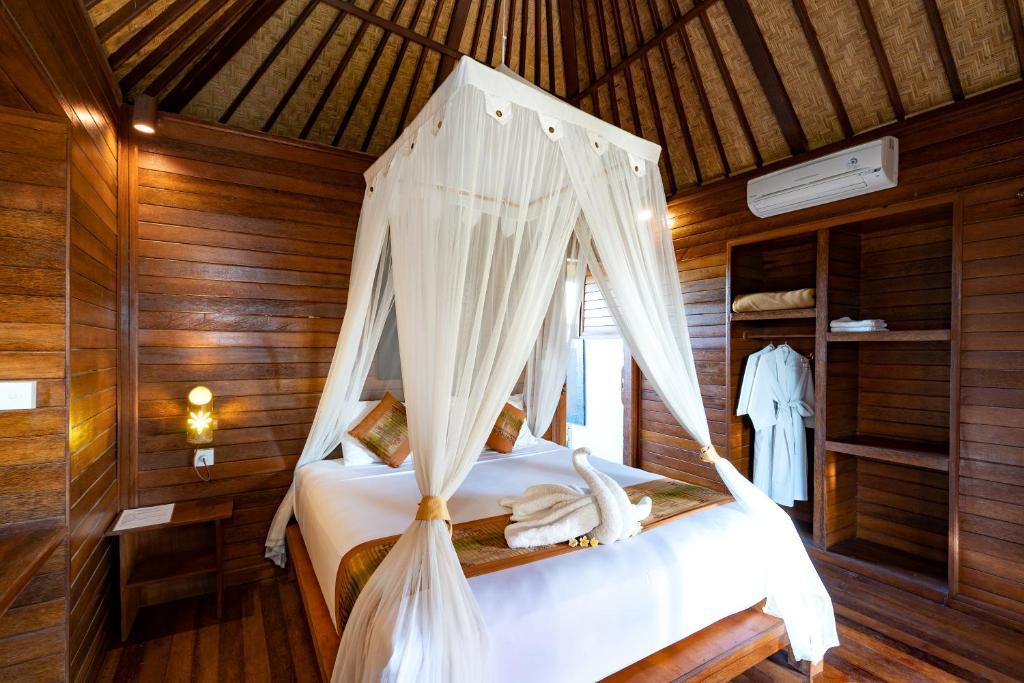 Ein Bett oder Betten in einem Zimmer der Unterkunft Smooth Garden