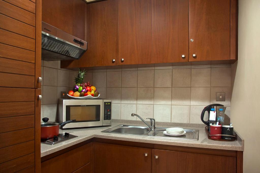 A kitchen or kitchenette at Al Rawda Arjaan by Rotana, Abu Dhabi