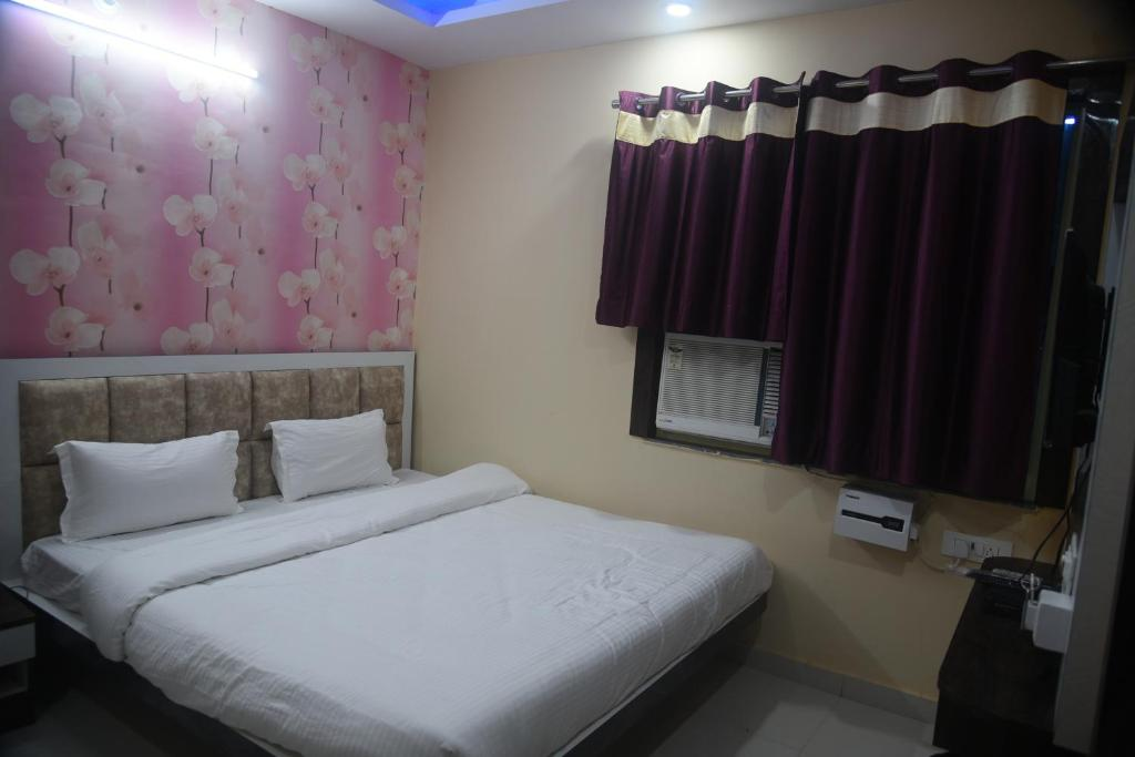 A bed or beds in a room at PREMA KUNJ RESORT