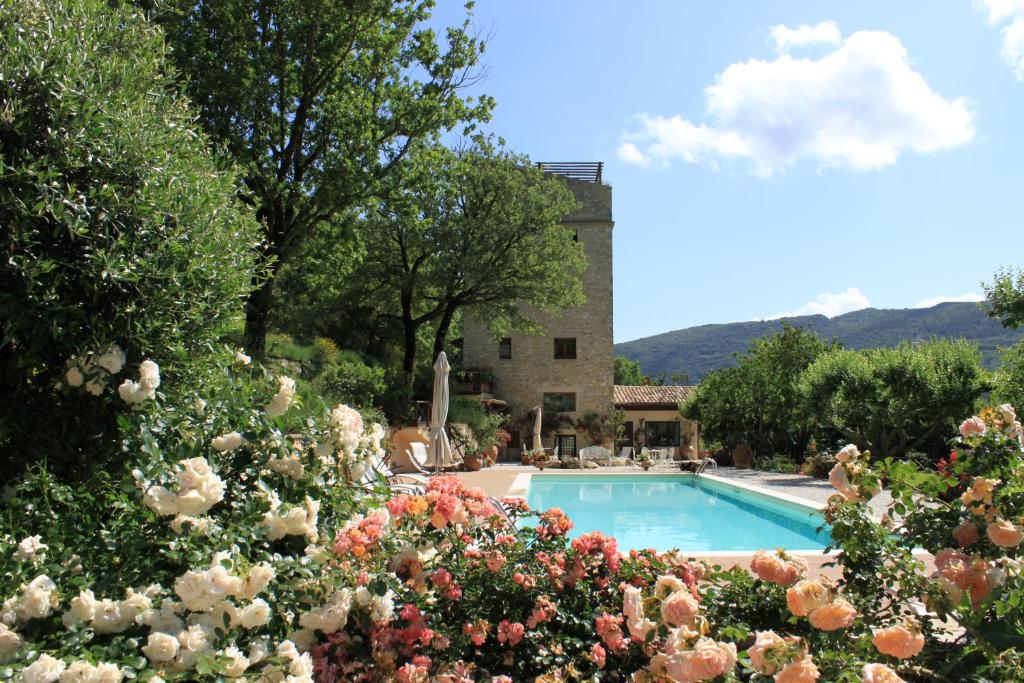 The swimming pool at or near Torre del Falco