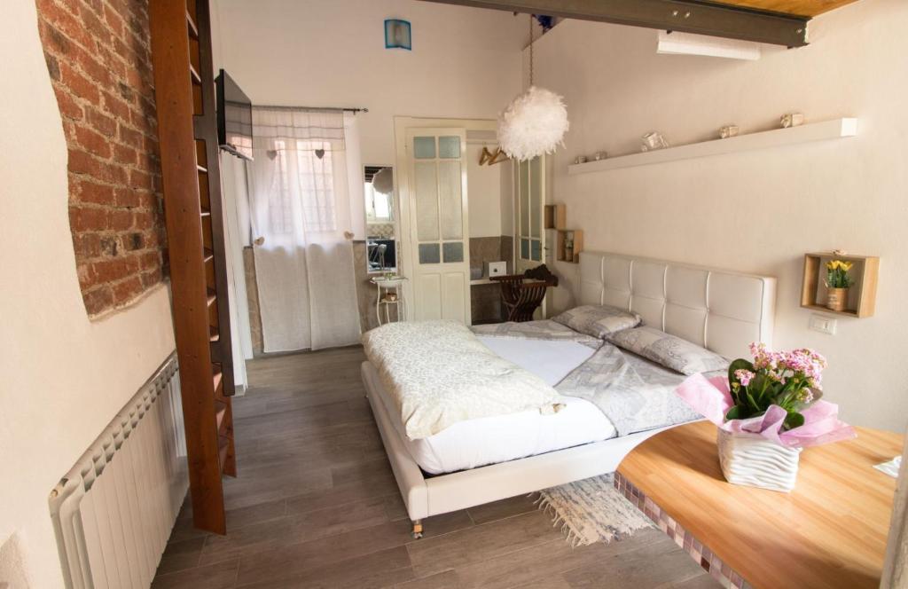 Letto o letti in una camera di Suite Maison 1706 Lago Orta