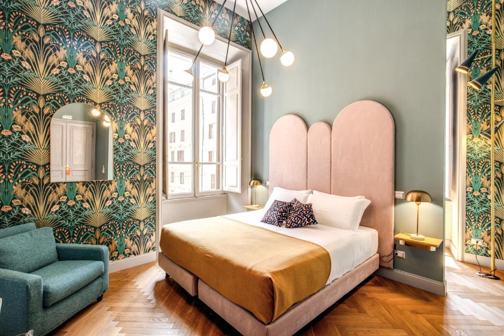 A bed or beds in a room at Glance in Rome