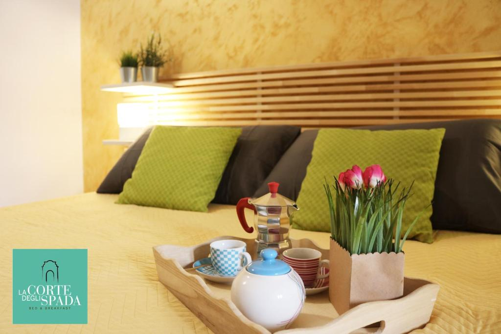 Ein Bett oder Betten in einem Zimmer der Unterkunft B&B La Corte degli Spada - Borgo Antico del Salento