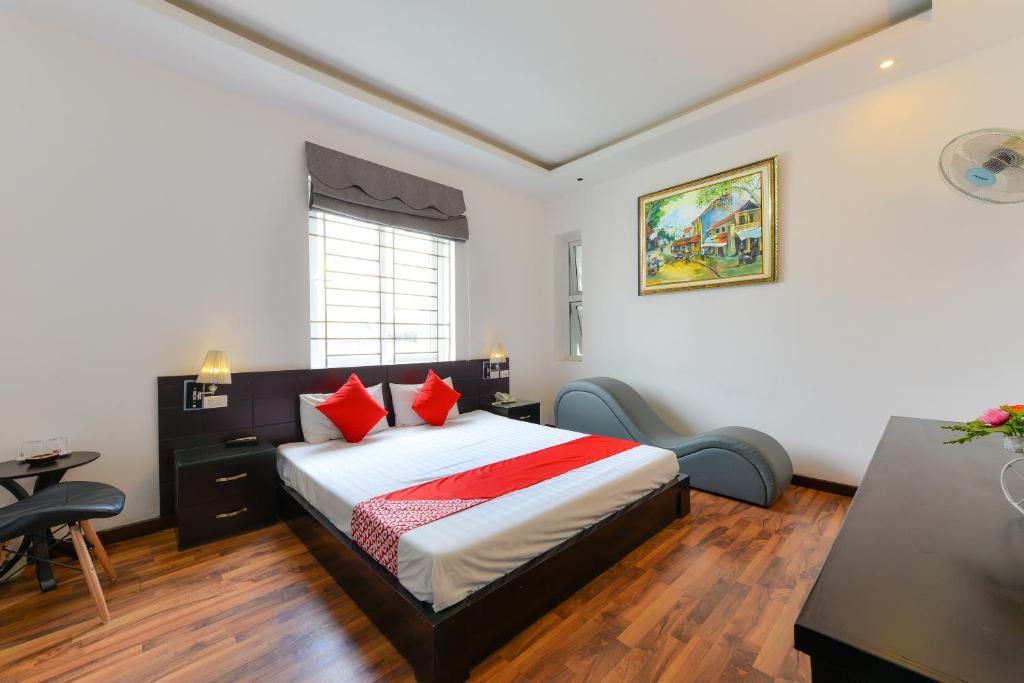 Letto o letti in una camera di OYO 293 Soho Hotel