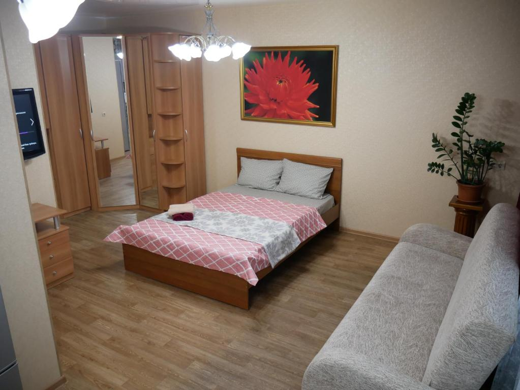 A bed or beds in a room at Квартира - студия