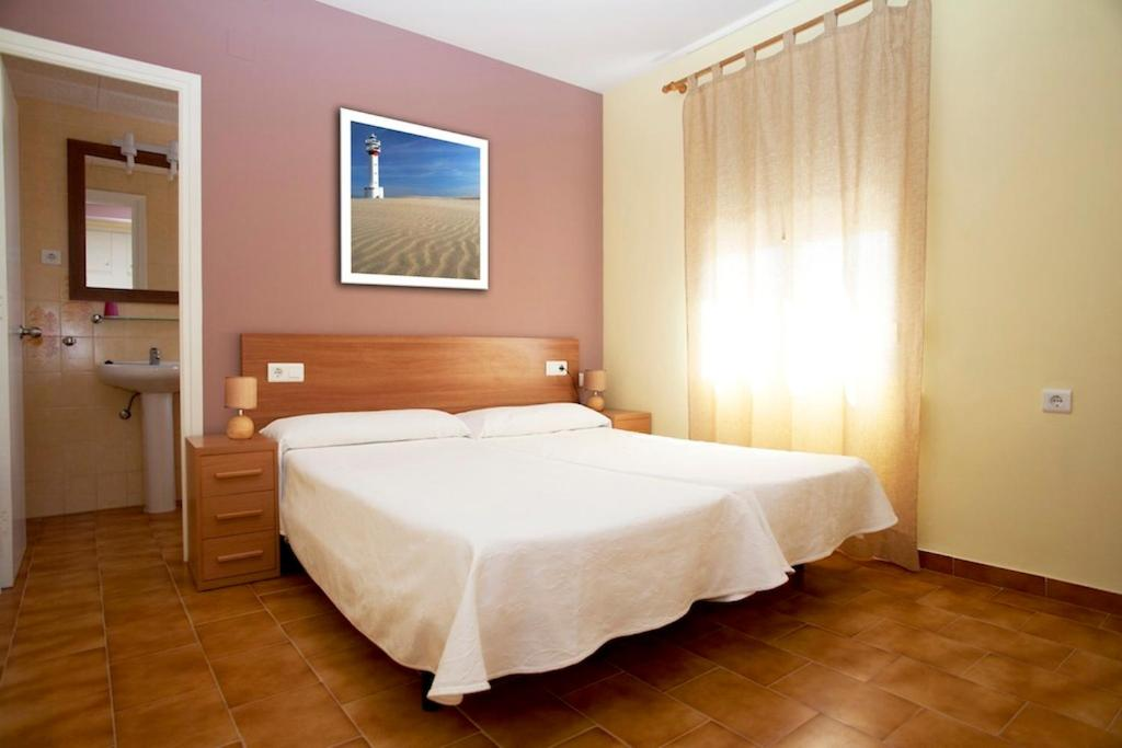 A bed or beds in a room at Nou Rocamar