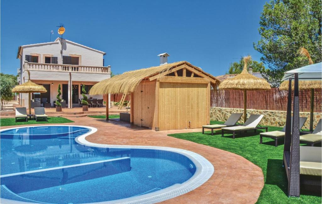 The swimming pool at or near Four-Bedroom Holiday Home in Son Serra de Marina
