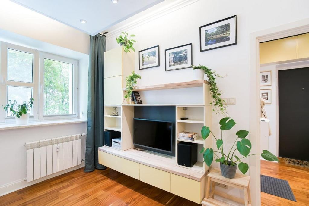 A television and/or entertainment center at Apartment in perfect location - Metro Ratusz Arsenał