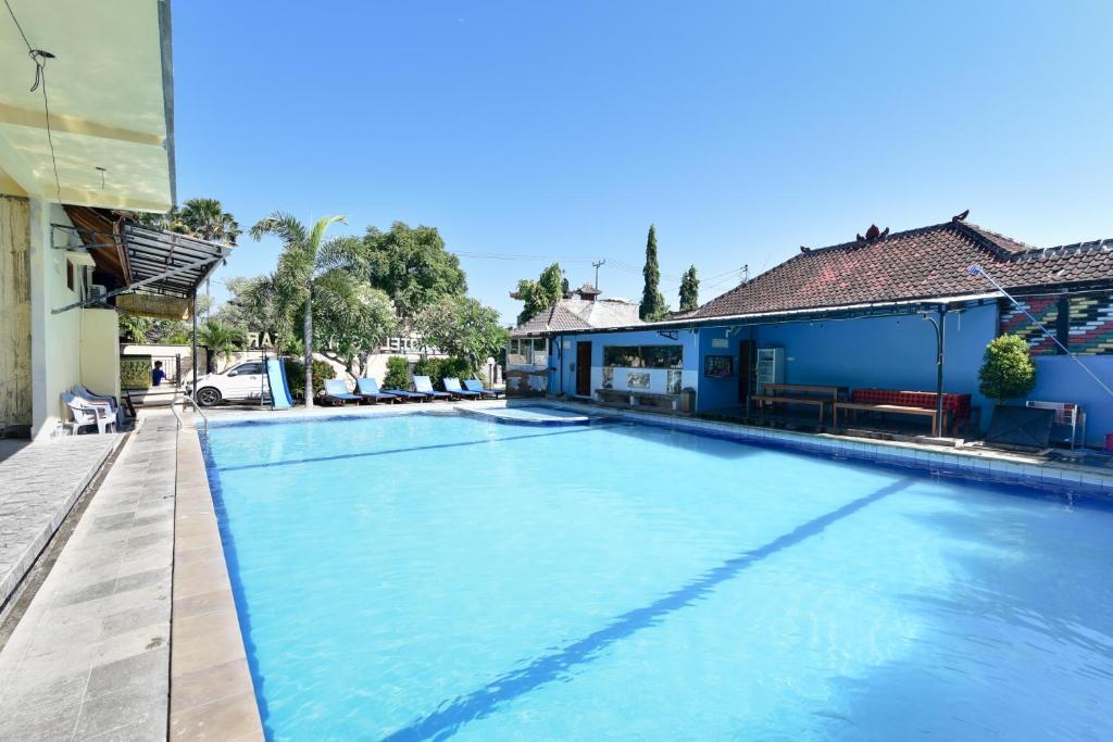 The swimming pool at or near RedDoorz Plus @ Singaraja