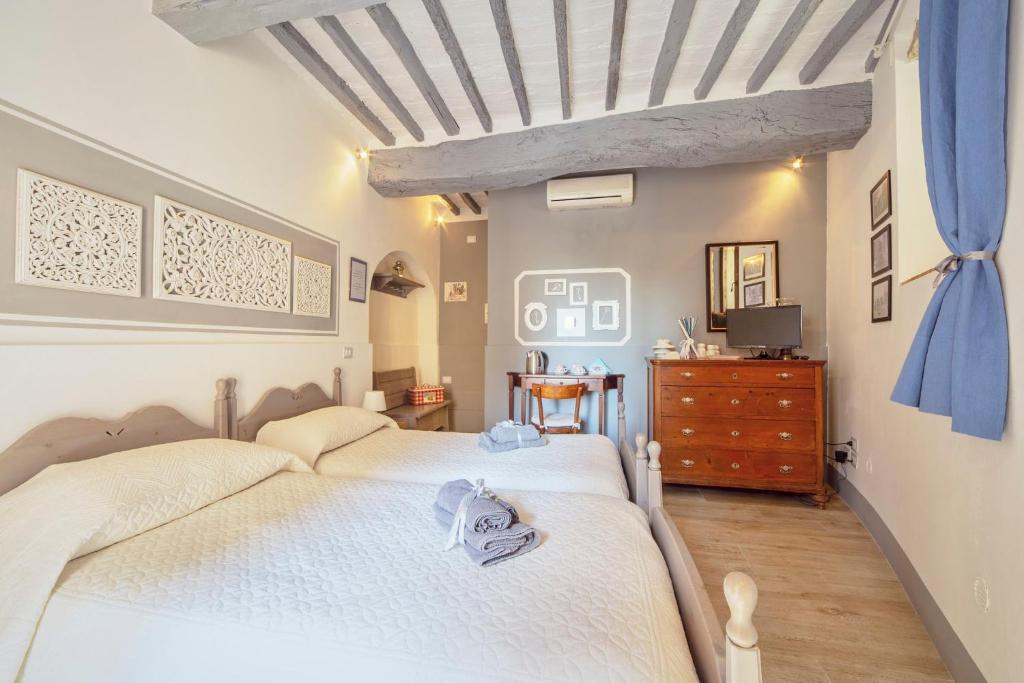 Un ou plusieurs lits dans un hébergement de l'établissement Affittacamere Maria Gabriella