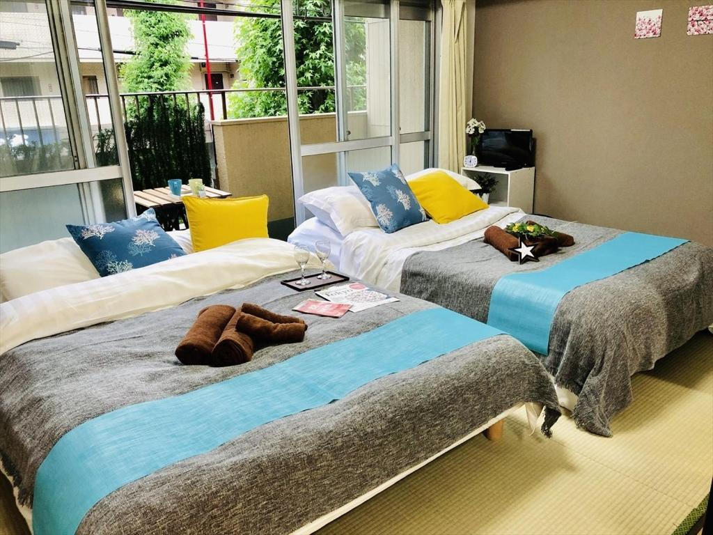 A bed or beds in a room at Itabashi-ku - Apartment / Vacation STAY 4560